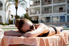 Sexy woman in bikini relax on sunlounger sunbathing Royalty Free Stock Image