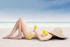 Sexy woman in bikini relaxing on beach Stock Photography