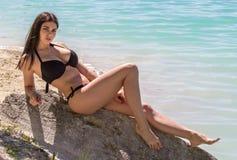 Sexy woman in bikini on sea background. Young sexy woman in a black bikini on sea background Stock Photo