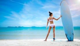 Sexy woman in the bikini on sea beach. Travel summer beach royalty free stock photo