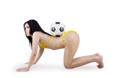 Sexy woman in bikini and soccer ball Stock Photos