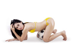 Sexy woman in bikini and soccer ball 1. Young sexy woman with a soccer ball and looking at camera. isolated on white background Stock Photos