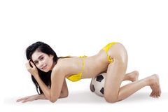 Sexy woman in bikini and soccer ball 2. Young sexy woman with a soccer ball and looking at camera. isolated on white background Royalty Free Stock Images