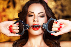 Sexy woman bite handcuffs bdsm Royalty Free Stock Images