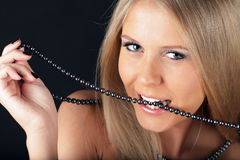 woman biting pearls stock images