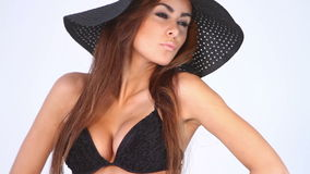 Sexy woman in black bikini and hat on white Royalty Free Stock Photography