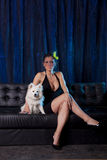 Sexy woman in black dres with white dog Royalty Free Stock Photography