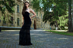 Sexy woman in black dress and necklace Royalty Free Stock Images