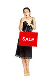 Sexy woman in black dress with shopping bags Stock Images