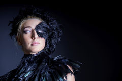 Sexy woman with black feather half mask Stock Image