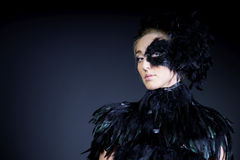 Sexy woman with black feather half mask Stock Images