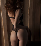 Sexy woman in black lingerie, mask and heels Stock Photos