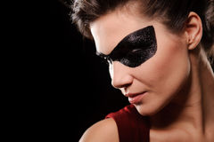 Sexy woman with black party mask on face Royalty Free Stock Image