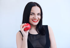 Sexy woman in black with red apple Royalty Free Stock Image