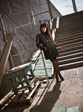 Sexy woman in black standing near stairs on street Stock Photos