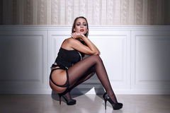 Sexy woman in black stockings squat Stock Photo