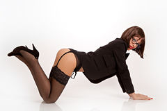 Sexy woman with black suit, suspenders and high heels Royalty Free Stock Photo