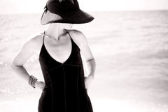 Sexy Woman in Black and White. A black and white portrait of a sexy woman wearing a long black dress at the beach Stock Images