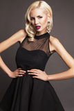 Sexy woman with blond hair in black dress Stock Photos