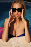 woman with blond hair in elegant bikini with sunglasses Stock Photography