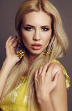Sexy woman with blond hair in elegant dress with bright makeup Stock Photos