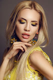 Sexy woman with blond hair in elegant dress with bright makeup. Fashion studio photo of beautiful sexy woman with blond hair in elegant dress with bright makeup Royalty Free Stock Photography