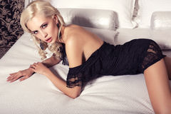 Sexy woman with blond hair in elegant lace dress Royalty Free Stock Photography