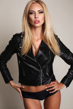 Sexy woman with blond hair in lingerie and leather jacket Stock Image