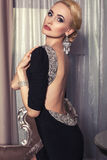 Sexy woman with blond hair in luxury dress with jewellery Royalty Free Stock Photography