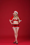 Sexy woman blonde in the clothes of Santa Claus Royalty Free Stock Photo