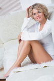 Sexy woman with blonde hair in a bedroom Stock Image