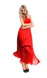Sexy woman in blown red dress Stock Images