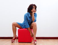 Sexy woman in blue denim and high heels Stock Photography