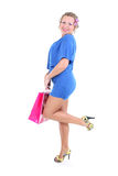 Sexy woman in blue dress with shopping bag Royalty Free Stock Photo