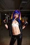 Sexy woman with blue hair holding two guns and looking as killer. Sexy woman with blue hair holding two guns and looking as a killer Royalty Free Stock Image