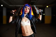 Sexy woman with blue hair holding two guns and looking as killer Royalty Free Stock Photography