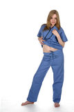 Sexy woman in blue scrubs. Lifting the edge of her shirt Royalty Free Stock Photo