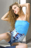 woman in blue top Stock Image