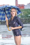 Sexy woman with blue  umbrella on rainy day Royalty Free Stock Photos