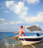 Woman on boat during summer Stock Image