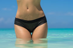 Sexy woman body on the beach background. Sexy woman body on the beach background Stock Images