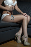 Sexy woman body holding handcuffs Royalty Free Stock Image