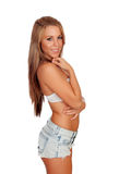 Sexy woman body in jean shorts. Isolated on a white background Stock Photos