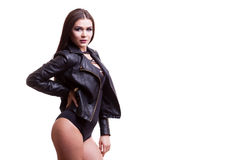 Sexy woman in body and leather jacket. Studio photo. Glamour and fashion Stock Image