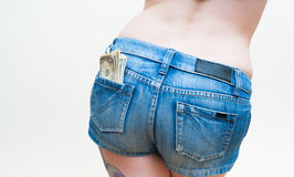 Sexy woman body part model with dollars in short jeans Stock Photography