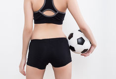 Sexy woman body with soccer ball. Sexy woman body in sports ware with soccer ball isolated on white background Stock Photography