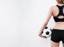 Sexy woman body with soccer ball. Sexy woman body in sports ware with soccer ball isolated on white background Royalty Free Stock Images