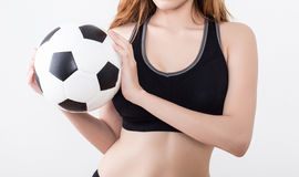 Sexy woman body with soccer ball. Sexy woman body in sports ware with soccer ball isolated on white background Royalty Free Stock Photo