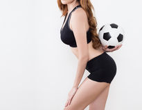 Sexy woman body with soccer ball. Sexy woman body in sports ware with soccer ball isolated on white background Royalty Free Stock Photography