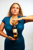 Sexy woman with bottle of rum Royalty Free Stock Photos